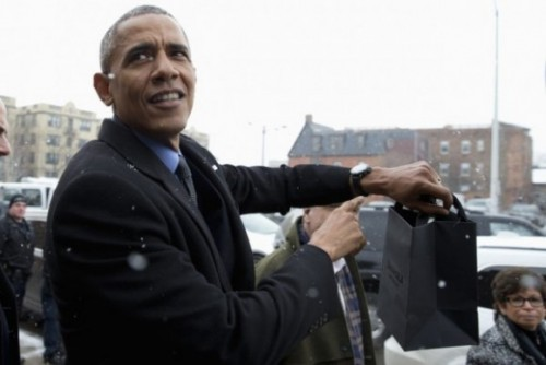 President Barack Obama points to his watch as he leaves a tour of Shinola, a domestic manufacturer of watches and other goods, Wednesday, Jan. 20, 2016, in Detroit.